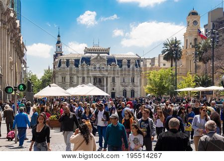 SANTIAGO CHILE - OCTOBER 23 2016: People walking on Plaza de Armas with Central Post Office Building (Correo Central) on the background. This is a historic house and a famous touristic attraction.