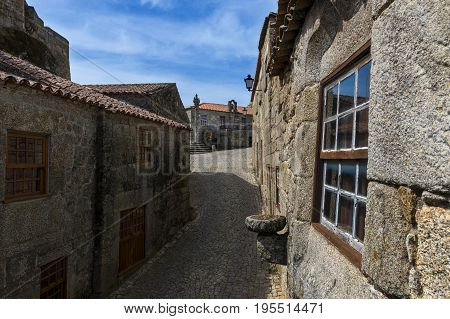 Narrow cobblestone street in the historic village of Sortelha in Portugal; Concept for travel in Portugal