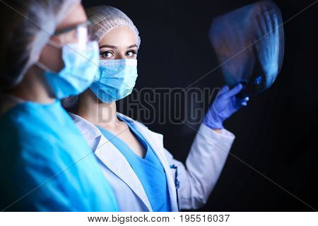 Medical team speaking of a X-ray in an operating room. Doctor. X-ray