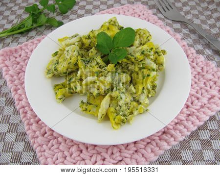 Aromatic herbal scrambled eggs with fresh watercress