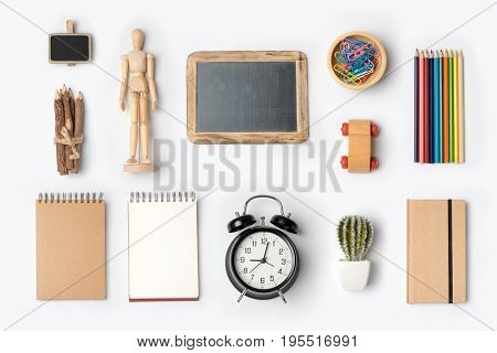 Back to school concept with school supplies organized on white background. Top view
