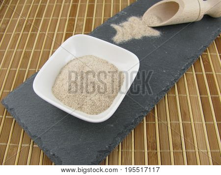 Ground psyllium seed husks on a slate plate