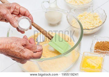 Traditional Colombian Arepa de Choclo Preparation : Adding salt to prepare sweet corn bread
