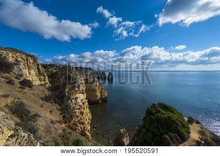 View of the sandstone cliffs at the Ponta da Piedade and the Lagos bay in Algarve Portugal; Concept for travel in Portugal and Algarve