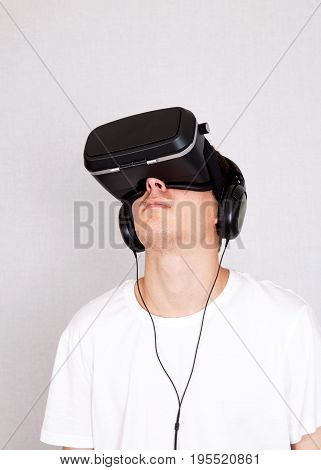 Young Man in Virtual Reality Headset in the Room