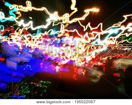Abstract blur colorful light lines, motion cars' lights and street lamps capture while driving on highway road at night. Use for background, backdrop - Copyspace at the bottom