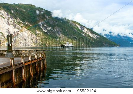 Ferry on the fjord with a rainbow in Norway