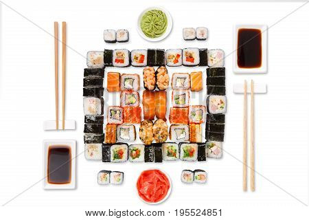 Japanese food restaurant delivery - sushi maki, unagi, gunkan and roll big party platter set isolated on white background, top view
