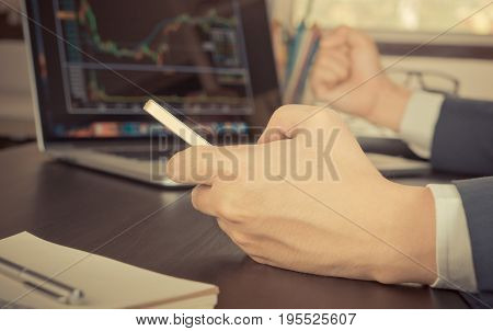 Stock Market Broker is trading stock on computer successfully