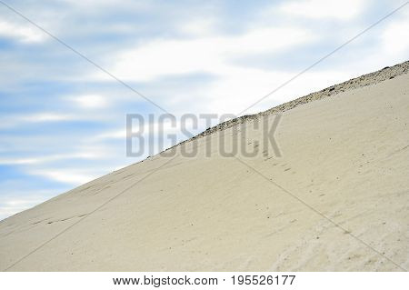 Extraction of sand, sand pit with water.