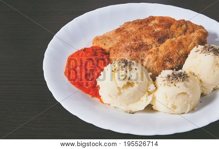 Plate of fresh, hot, crispy fried chickenand mashed potatoes on a wood table. Food concept.