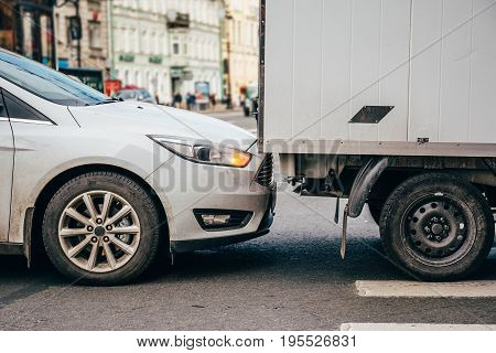 Small car accident, a white sedan crashed into a truck
