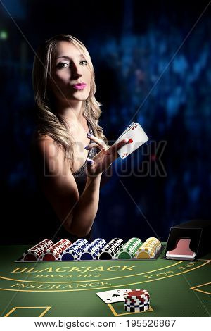 sexy woman at blackjack casino table with poker cards