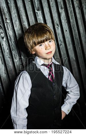 Little Serious Boy Posing In Official Suit