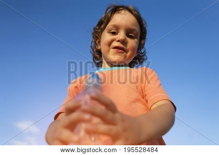 Child With A Bottle Of Water.