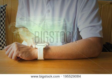 Sport Man Or Male Hand Use Smartwatch Or Wireless Wearable Device