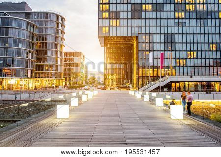 Sunset view on the Medienhafen financial district with modern illuminated buildings in Dusseldorf city, Germany
