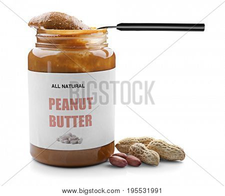 Creamy peanut butter in spoon and jar on white background
