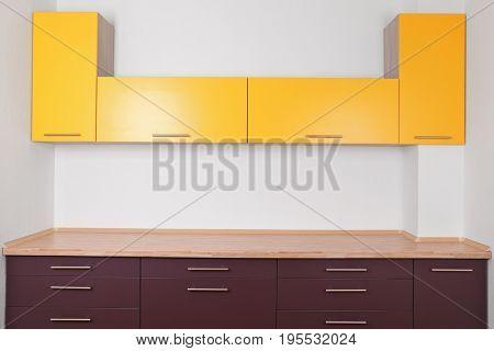 Interior of modern kitchen with empty bright furniture