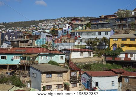 VALPARAISO, CHILE - July 14, 2017: Colourful houses on one of the hillsides making up the UNESCO World Heritage City of Valparaiso in Chile.