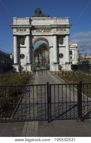 VALPARAISO, CHILE - July 14, 2017: White marble arch set in landscaped gardens in Valparaiso, Chile. The arch was donated to the city of Valparaiso by the British community to commemorate the 100th anniversary of the independence of Chile.