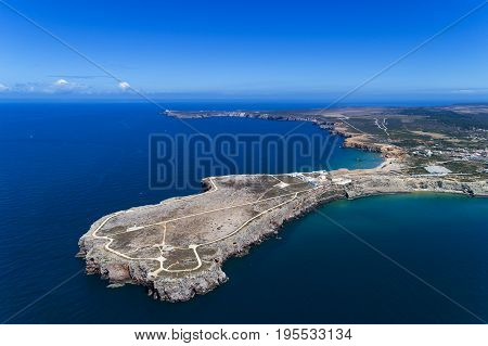 Aerial view of the Sagres Sagres Point with the Saint Vincent Cape (Cabo de Sao Vincente) on the background in Algarve Portugal