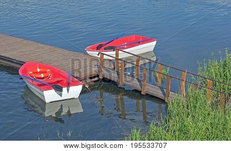 small pleasure boats moored to the banks of the river