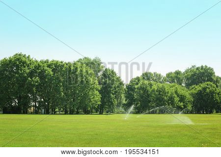 Landscape with big golf course on sunny day