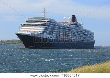 IJmuiden The Netherlands - June 5th 2017: Queen Victoria Cunard on North Sea Channel towards North Sea Lock in IJmuiden