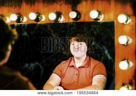 Red-haired Boy Posing In Front Of Mirror