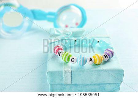 Bracelet with baby name NOAH on gift box