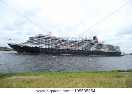 Velsen The Netherlands - June 7th 2017: Queen Victoria Cunard on North Sea Channel in heavy weather towards IJmuiden sea lock and North Sea