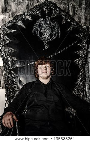 Red-haired Boy Sitting On The Magic Throne