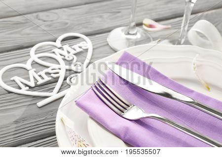 Beautiful table setting for lesbian wedding on wooden background