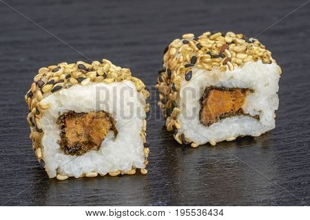 two sushi dish on dark grey stone surface