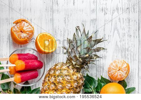 Fruits. Oranges on wooden background top view copyspace.