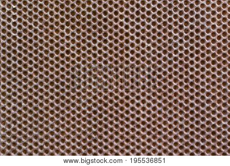Abstract metallic rusty background with round holes