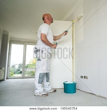 Painter during the renovation of an apartment