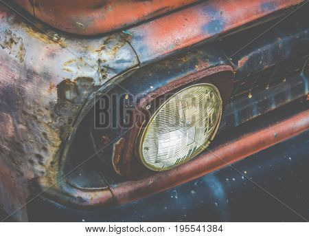 Detail Of The Headlight Of A Rusty Old Vintage Truck