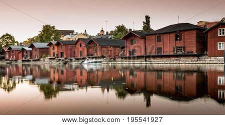 Red shore houses on the riverbank of Porvoo river. Porvoo, Finland. Old town of Porvoo in Finland late afternoon. poster