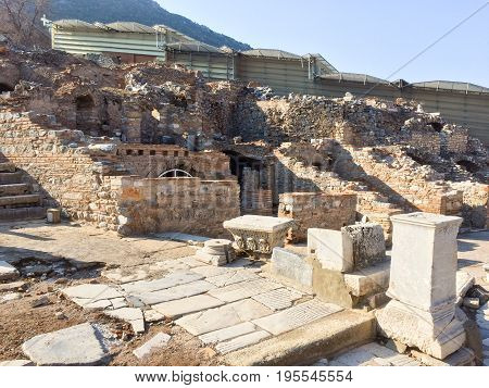 Roman Stone Pillars And Terraced Hosues Ruins On Road Side In Ephesus Archaeological Site In Turkey