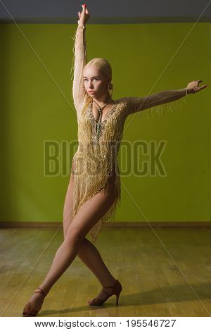 Beautiful woman dancing active ballroom dance in classroom.