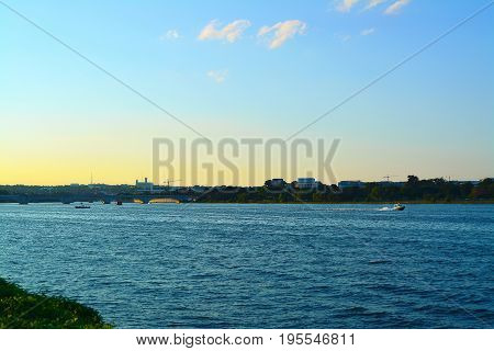 Photo of Potomac River at sunset with Arlington Memorial Bridge and the Lincoln Memorial visible