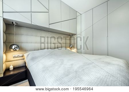 Modern bedroom in gray finishing and queen size bed