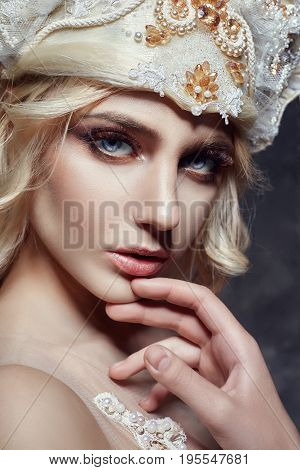 Art fashion Blonde girl with long eyelashes and clear skin. Skin care and lashes. Beautiful lips. Princess Queen fairy