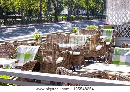 Thatched chairs in a cafe in a European style