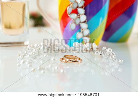 Rings and accessories for lesbian wedding on table