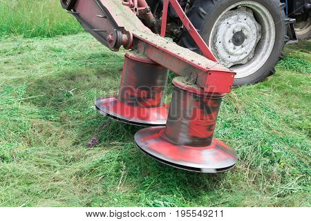 Rotating tractor mower in the working position attached to the tractor