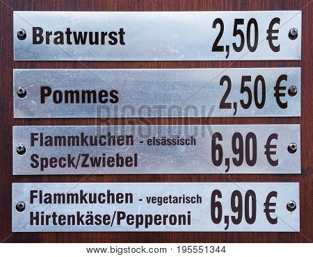 Price tags with prices for food at a snack bar in Magdeburg