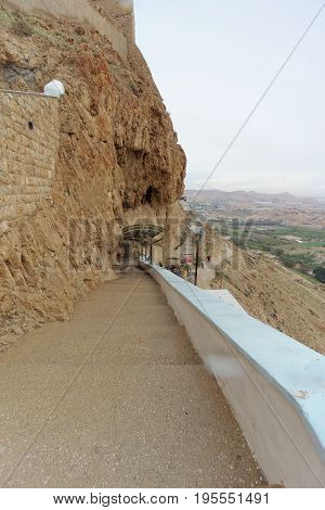 Jericho, Israel. - February 16.2017. View of the Mountain of Temptation and the Convent of Temptation in Jericho. Way up.